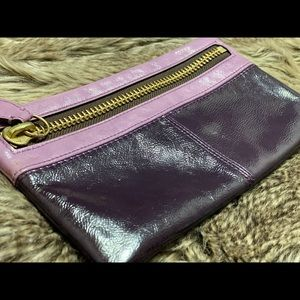 Two tone purple Coach clutch with zipper